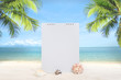 Summer sandy beach with blank white wall mockup and coconut tree on blur ocean and sky background.