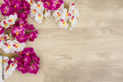 white-and-purple-orchids-on-wooden-surface