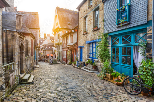 Fototapety, obrazy: Charming street scene in an old town in Europe at sunset