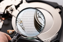 Hard Disk And Magnifier Close-up