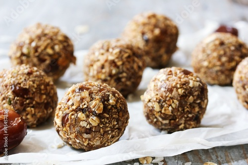 Fototapeta Dates oatmeal balls / No cook energy bites, selective focus