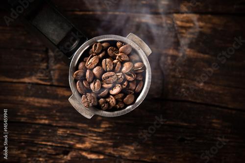Fotobehang Koffiebonen Fresh coffee beans in coffee maker.