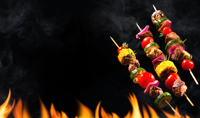 Fototapeta Do steakhouse Collage of grilled meat skewers and vegetables