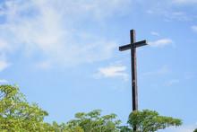 Wood Cross On Blue Sky. Christian Background.
