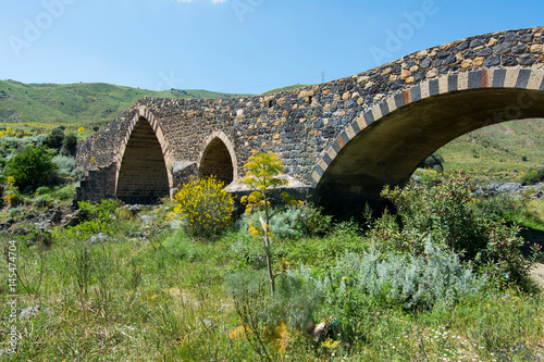 Fényképezés  Medieval bridge of Adrano, Sicily, of arabic origin and saracen
