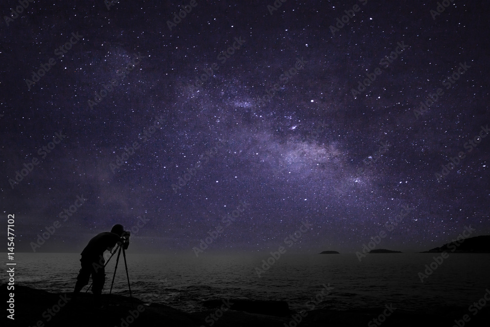 Fototapeta Photographer doing photography nightscape with milky way galaxy.