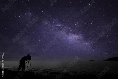 Fototapeta Photographer doing photography nightscape with milky way galaxy. obraz
