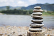 Natural background of stone stack over blurred river background, outdoor day light