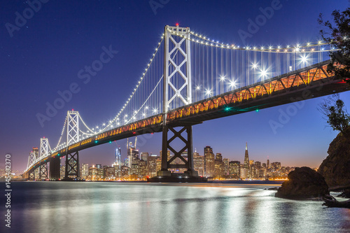 Deurstickers San Francisco San Francisco skyline with Oakland Bay Bridge at night, California, USA
