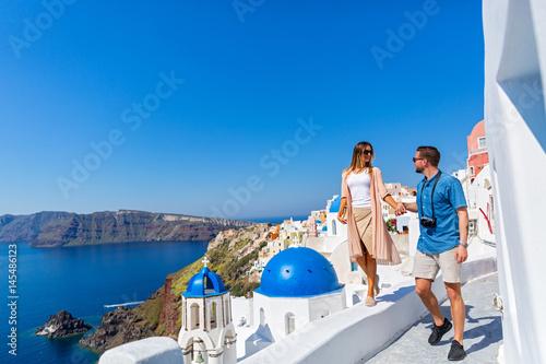 Fototapeta Young couple walking on Santorini obraz