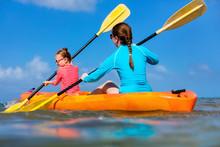 Family Kayaking At Tropical Oc...