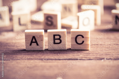 Photo wooden elements with the letters collected in the word abc