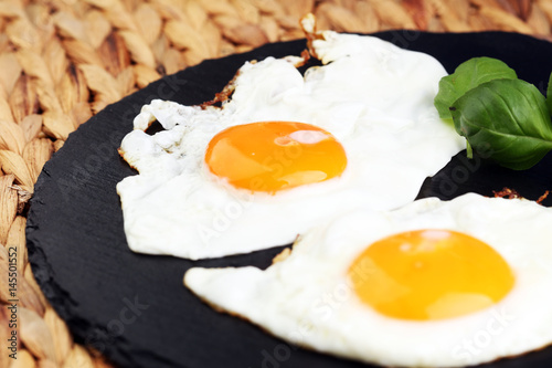 Foto op Plexiglas Gebakken Eieren fried eggs with basil pepper and salt