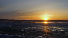 Sunset Over A Large Pond. The Lake Is Covered With Loose Ice. The Ice Is Moving. Small Clouds Are Floating In The Sky. Spring Sunny Evening.  Time  Lapse Footage.