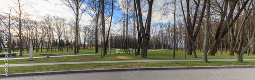 Spring landscape in a city park, panoramic view. Victory Park, Minsk, Belarus.