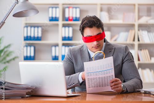 Fotografie, Obraz  Blindfold businessman sitting at desk in office
