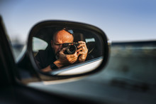 Self Portrait In A Rearview Mirror Of A Car