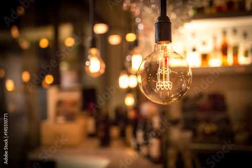 Photo  Vintage lamp bulb with bar or cafe night abstract background