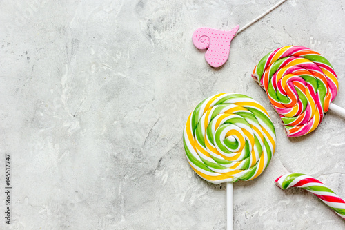 lollipop design with sugar candys on gray background top view mockup