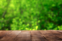 Empty Wooden Table With Blur G...