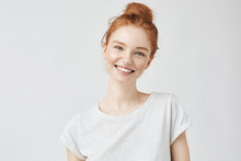 Portrait Of Smiling Redhead Woman
