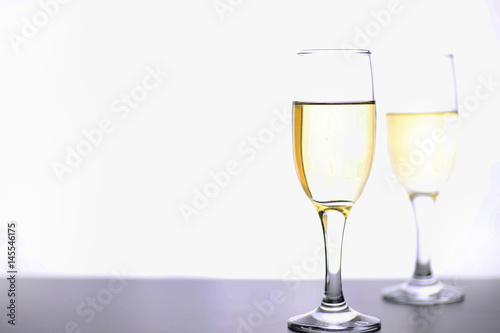 Foto op Canvas Alcohol glass of white wine on a table on white background isolate