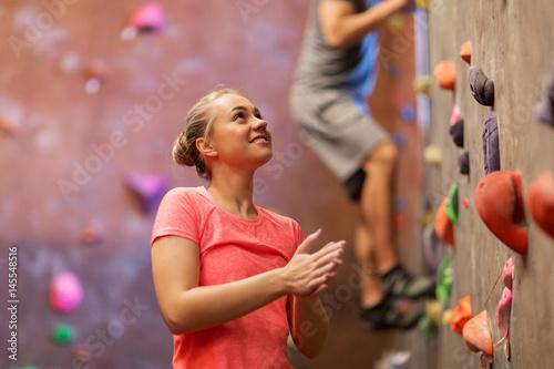 Fotografie, Obraz  man and woman exercising at indoor climbing gym