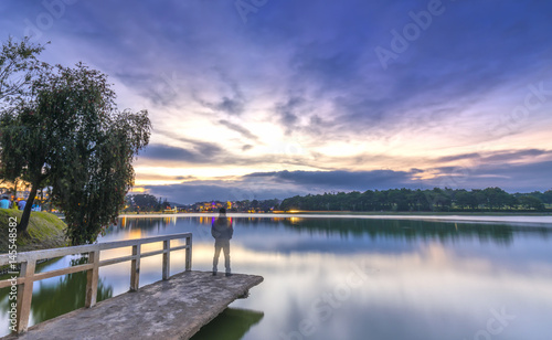 Foto auf Acrylglas Bestsellers Da Lat, Vietnam - March 27th, 2017: Sunset on the shores of Xuan Huong Lake with dramatic sky makes the scenery more romantic, attracting tourists to visit in Dalat, Vietnam.