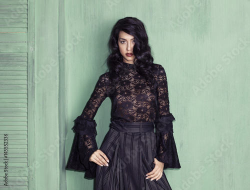 Fotografie, Obraz  Model wearing black troussers and blouse