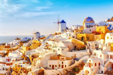 Skyline of Oia, traditional white architecture with windmills, greek village of Santorini, Greece . Santorini is island in Aegean sea, famous summer resort.