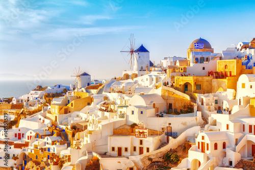 Fototapeta Skyline of Oia, traditional white architecture with windmills, greek village of Santorini, Greece . Santorini is island in Aegean sea, famous summer resort. obraz