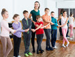 children studying folk style dance in class