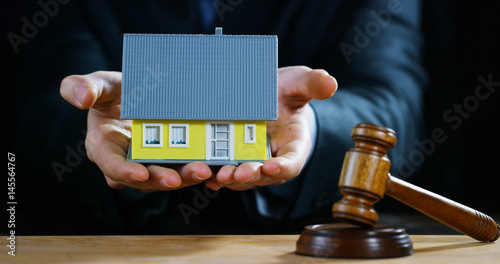 Photo auction scene of lawyers or notaries with gavel judge for the insurance compensation or criminal cases