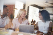 Businesspeople Meeting In Coffee Shop Shot Through Window