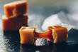 Caramel fudges on dark background