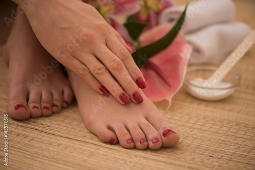 Deurstickers Pedicure female feet and hands at spa salon