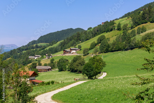 Tuinposter Pistache Typical mountain landscape and house in the Dolomites, south Tyrol