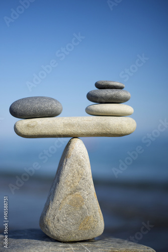 Fotografie, Obraz  Balancing of black and white pebbles on the top of stone