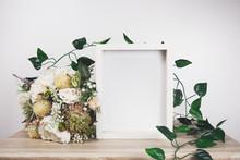 White Frame Mockup With Flower...