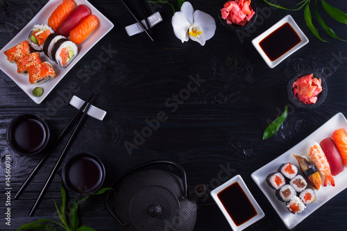 Japanese sushi dish frame on black wooden background with copy space Canvas Print