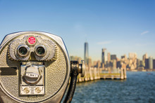 Close Up Of Tower Viewer Binoculars With Blurred New York City Skyline