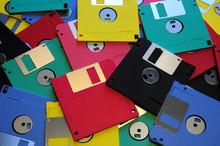 Multicolored Floppy Disc 3.5 For Old Computers. Aligned As Background.