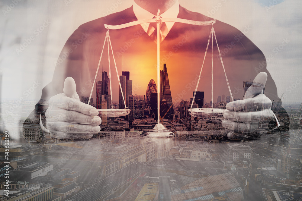 Fototapeta justice and law concept.Male judge in a courtroom with the balance scale on wood table