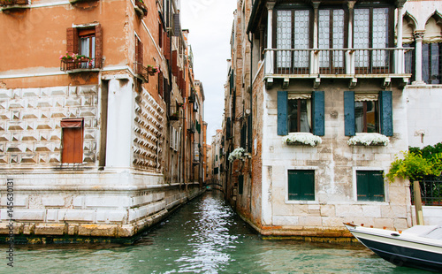 Fototapety, obrazy: Colored facades of Venice houses and a view of the canal with tourist taxi cabs. Italy, a sunny summer day.