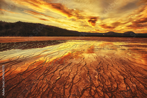 Fototapeta Dramatic sunset at Grand Prismatic Spring in Yellowstone National Park, Wyoming, USA