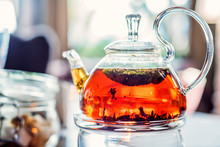 Modern Glassy Teapot With Fres...