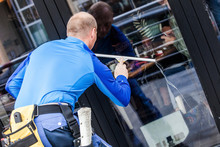Window Washer Working  At Buil...