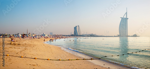 DUBAI, UAE - MARCH 30, 2017: The evening skyline with the Burj al Arab and Jumeirah Beach Hotels and the open Jumeriah beach Canvas Print