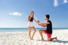 Marriage Proposal Couple On The Beach