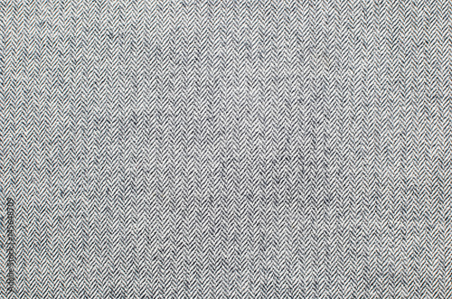 Foto Light grey woolen or tweed fabric for grunge background